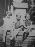 With my sisters, when I was four years old.