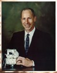 My official portrait when joining NASA, holding a Lunar Module model.
